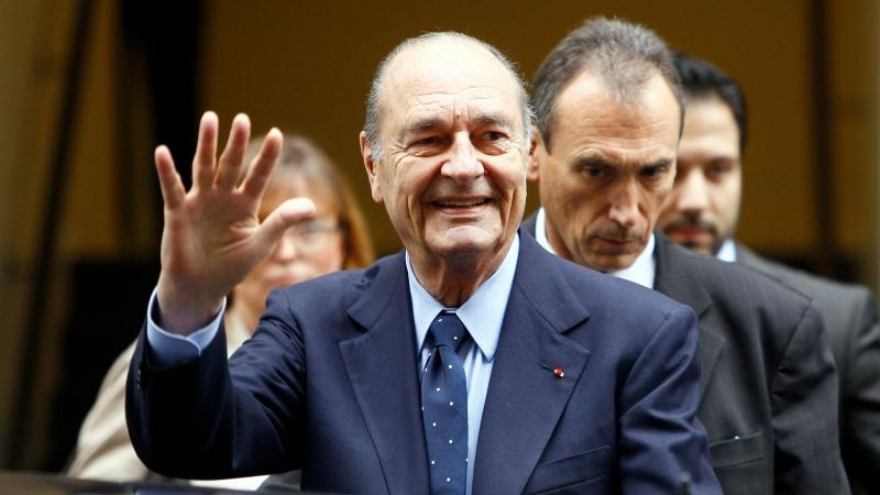 In this Thursday, Nov. 24, 2011 file photo, Former French President Jacques Chirac waves to the press after a ceremony awarding laureates of the Fondation Chirac at Quai Branly Museum in Paris. (Francois Mori/AP)