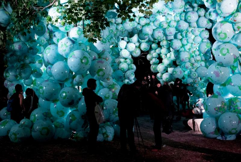 People walk through the 'Walk among Worlds' installation during the 2014 Scotiabank Nuit Blanche in Toronto. (Hannah Yoon/The Canadian Press)