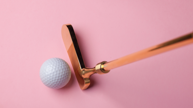 A gold putter is seen in this stock image from Shutterstock.com