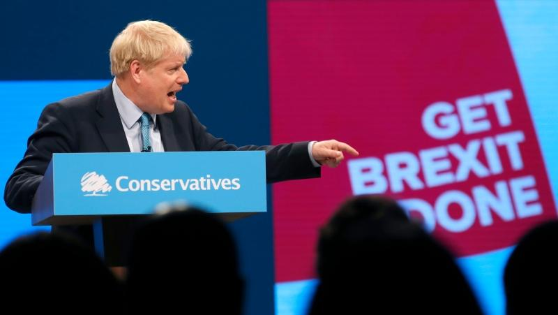 Britain's Prime Minister Boris Johnson points as he delivers his Leader's speech at the Conservative Party Conference in Manchester, England, Wednesday, Oct. 2, 2019. (AP Photo/Frank Augstein)