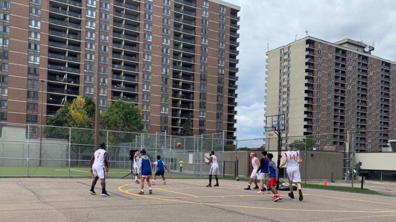 Peel Regional Police basketball team played with youth from the neighbourhood at 85 Charolais Boulevard in Brampton, where a tennis space was transformed into a basketball court.