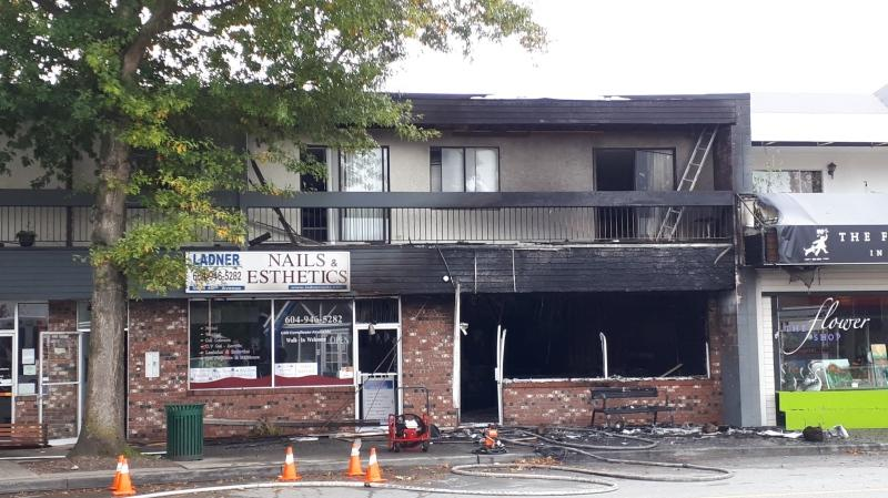 A tattoo shop went up in flames in Delta on Wednesday. (Chief Neil Dubord/Twitter)