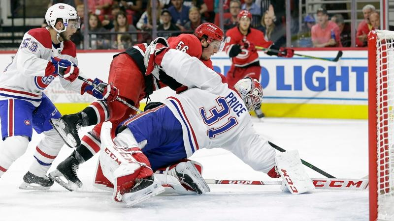 Montreal Canadiens goaltender Carey Price (31) blocks Carolina Hurricanes left wing Erik Haula (56), of Finland, while Canadiens defenceman Victor Mete (53) watches during the second period of an NHL hockey game in Raleigh, N.C., Thursday, Oct. 3, 2019. (AP Photo/Gerry Broome)