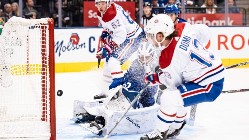 Montreal Canadiens centre Max Domi (13) scores on Toronto Maple Leafs goaltender Michael Hutchinson (30) during first period NHL action in Toronto, Saturday, Oct. 5, 2019. THE CANADIAN PRESS/Christopher Katsarov