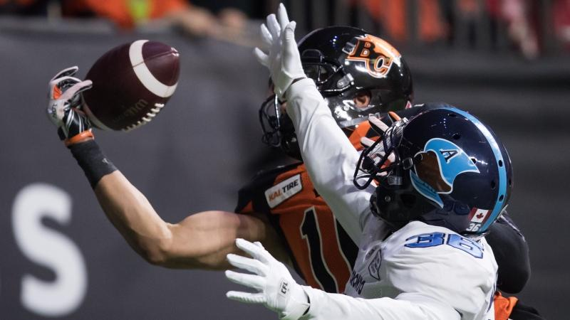 B.C. Lions' Bryan Burnham, back, makes a one-handed catch in the end zone to score his second touchdown as Toronto Argonauts' Trumaine Washington defends during first half CFL football action in Vancouver, Saturday, Oct. 5, 2019. THE CANADIAN PRESS/Darryl Dyck