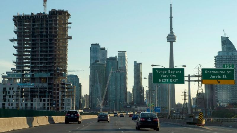 Construction cranes feature on the skyline in Toronto seen from the Gardiner Expressway on Wednesday, July 5, 2017. . THE CANADIAN PRESS/Frank Gunn