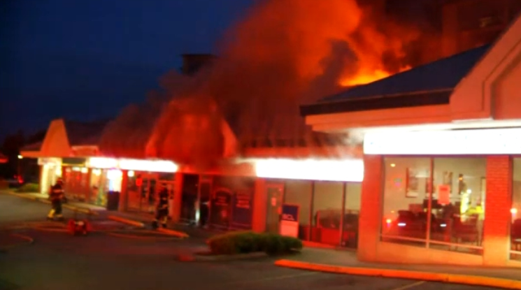 Crews battle a fire at an Abbotsford laundromat on Oct. 6, 2019.