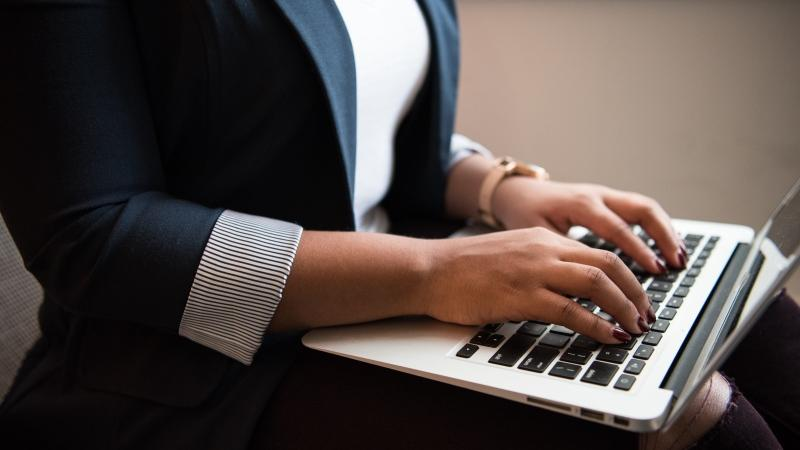 A woman on a laptop seen in this file photo. (Christina Morillo / Pexels)