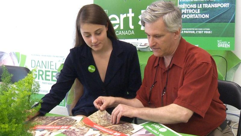 Casandra Poitras sits with Deputy Green Party Leader Daniel Green.