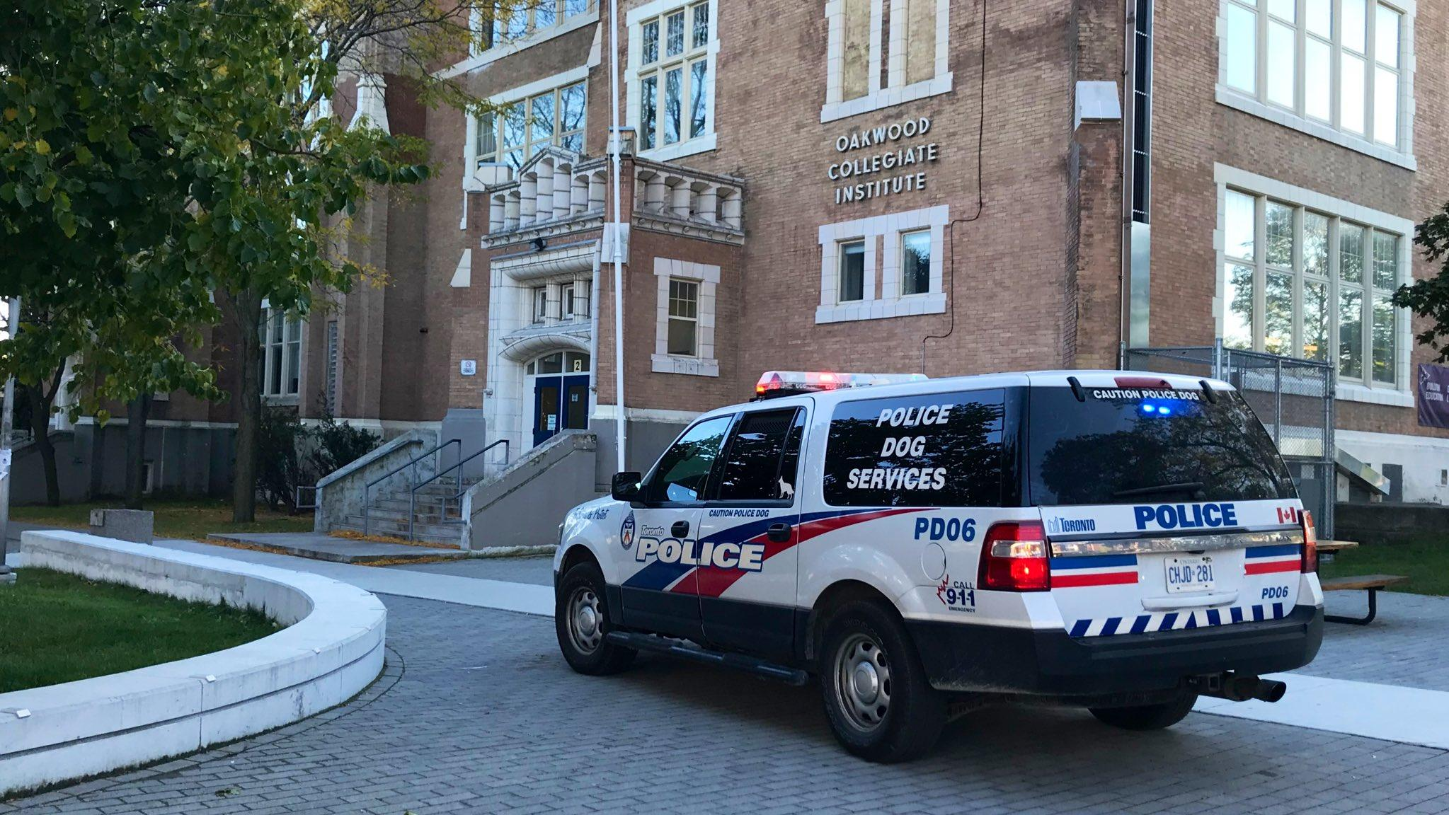 A police vehicle sits outside of Oakwood Collegiate