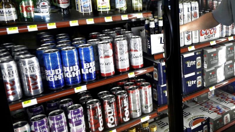 This file photo shows the beer cooler behind the counter in a convenience store in Sheridan, Ind . (AP Photo/Michael Conroy)