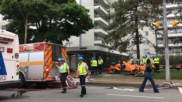 Firefighters and paramedics at the scene of a highrise fire in St. James Town on August 21, 2018.