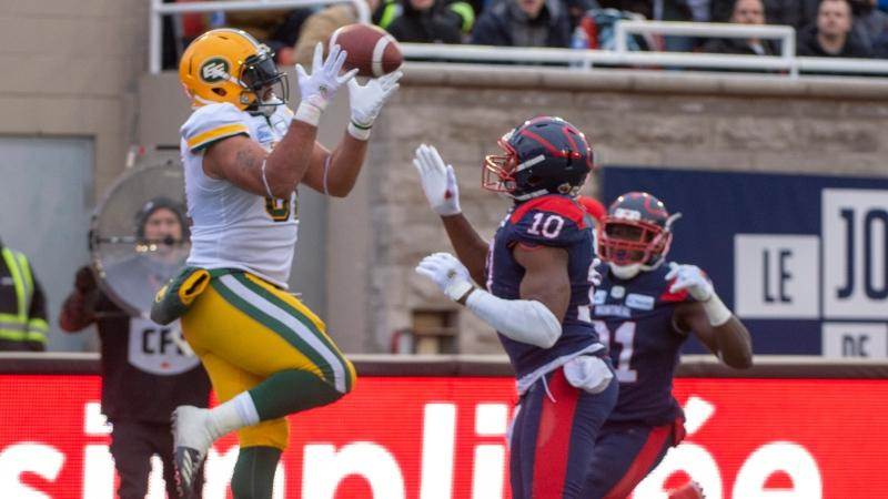 Edmonton Eskimos fullback Calvin McCarty (31) scores a touchdown as Montreal Alouettes Henac Muamba looks on during second quarter CFL Eastern semi-final football action Sunday, November 10, 2019 in Montreal. THE CANADIAN PRESS/Ryan Remiorz