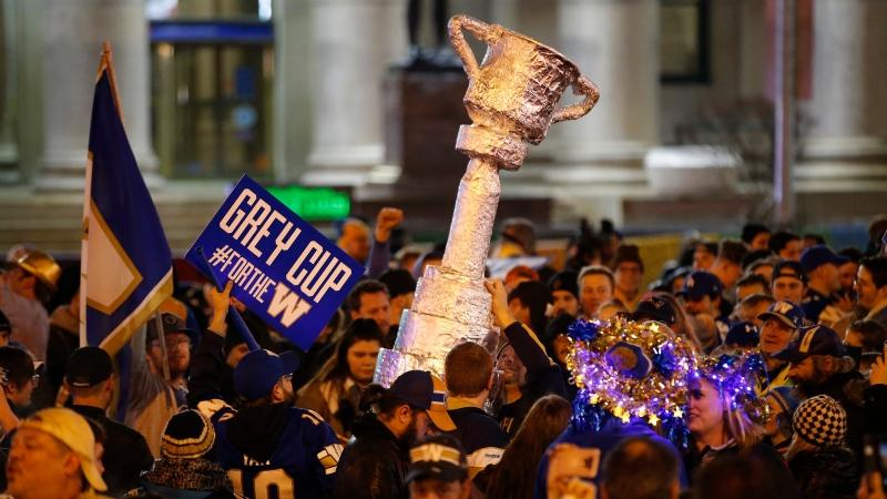 Winnipeg Blue Bomber fans celebrate winning the 107th Grey Cup over the Hamilton Tiger Cats at the intersection of Portage and Main in Winnipeg Sunday, November 24, 2019. It's been 29 years since the Bombers last won the Grey Cup. THE CANADIAN PRESS/John Woods