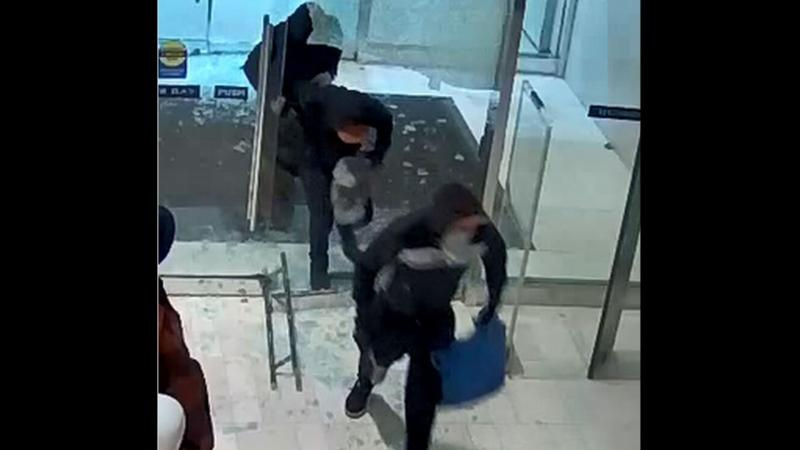 Three of four suspects who allegedly broke through the front doors of a HBC at Sherway Gardens Mall are shown in this surveillance camera image. (Toronto Police Service)