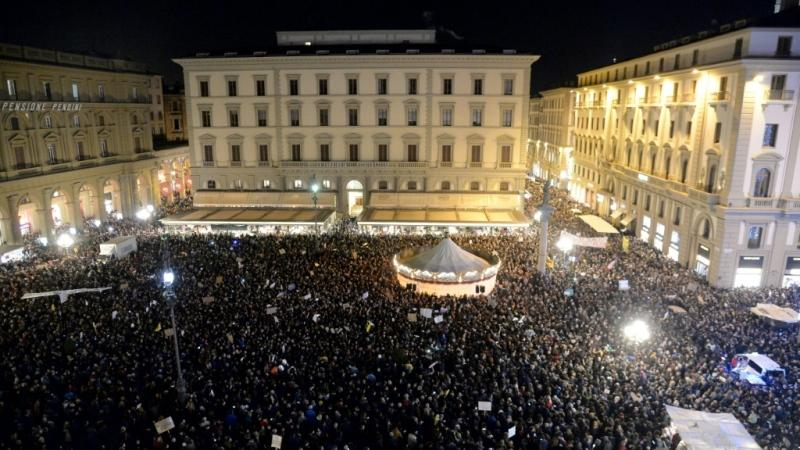 Thousands gathered in Florence's Piazza della Republic in answer to a call from the new 'Sardine Movement.' (AFP)