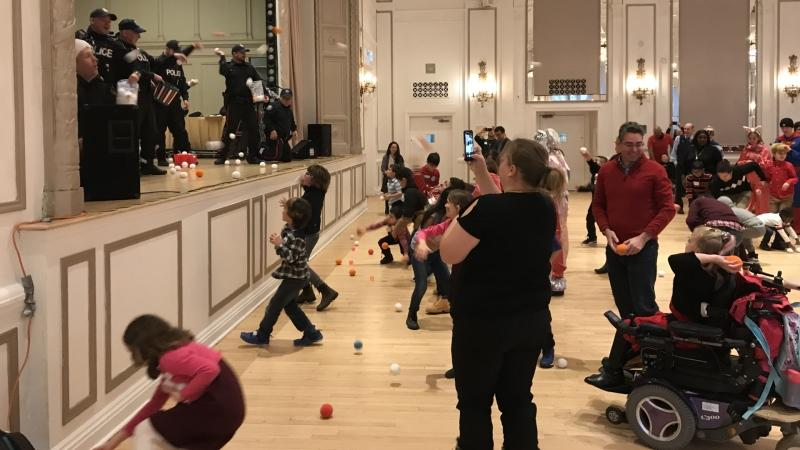 Children played with police officers at the The Rotary Club of Toronto's annual Christmas party on Sunday, Dec. 1, 2019. (Nick Dixon/CTV News Toronto)