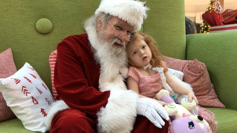 Evanna Irvine, 5, sits with Santa Claus during a low-sensory event at the Southcentre Mall on Dec. 1.