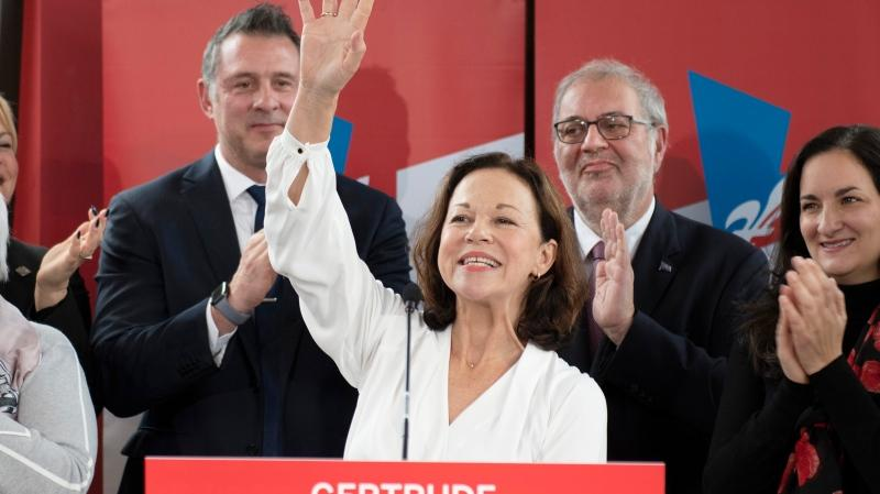 Quebec Liberal candidate in Jean-Talon Gertrude Bourdon waves at supporters while Quebec Liberal Leader Pierre Arcand, second right, applauds Tuesday, October 29, 2019 in Quebec City. THE CANADIAN PRESS/Jacques Boissino