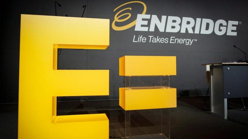 Enbridge company logos are shown on display at the company's annual meeting in Calgary, May 12, 2016. (Jeff McIntosh / THE CANADIAN PRESS)