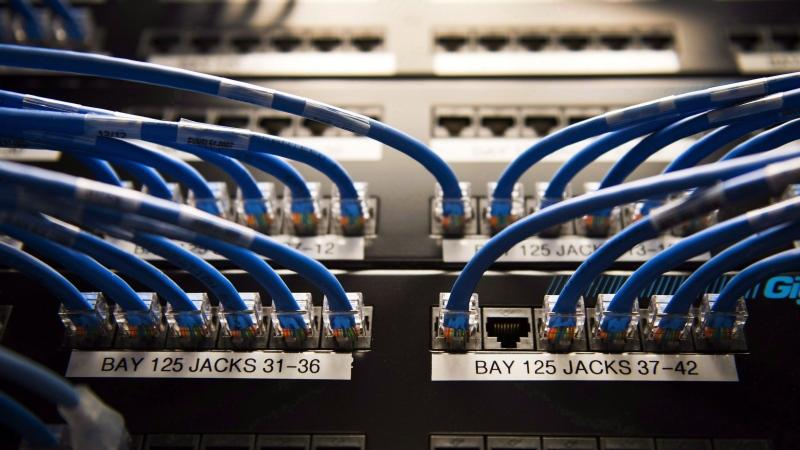 Networking cables and circuit boards are shown in Toronto on Wednesday, November 8, 2017. Internet advocacy groups say they're unhappy Canada's telecoms regulator has halved the minimum speed that projects need to meet for a $750-million fund designed to make broadband internet more accessible. (THE CANADIAN PRESS/Nathan Denette)
