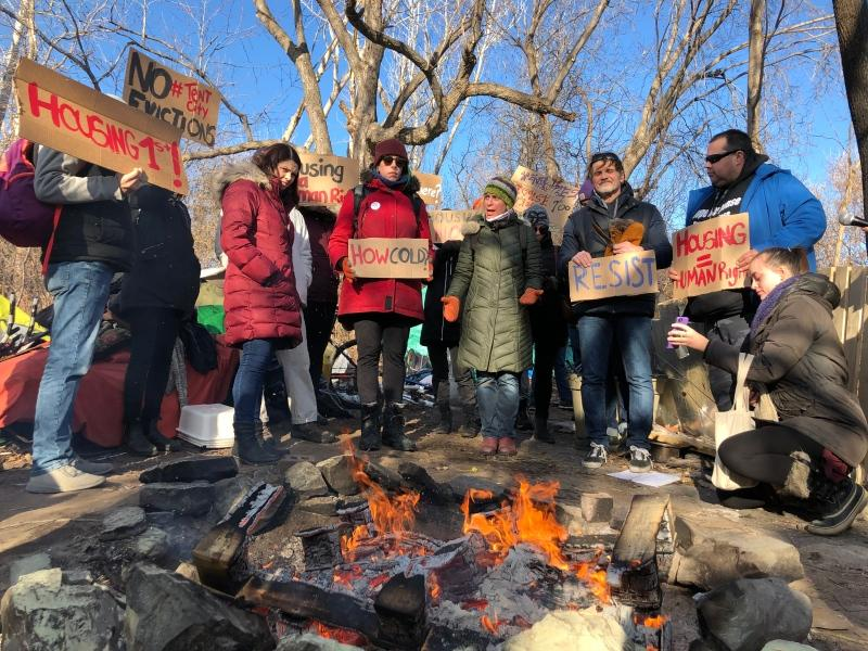 "International housing and human rights activists hold rally at Ottawa's ""tent city""."