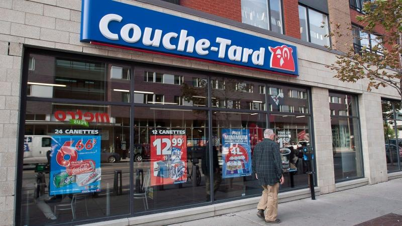 A man passes by a Couche-Tard convenience store in Montreal, on Oct. 5, 2012. (Graham Hughes/THE CANADIAN PRESS)
