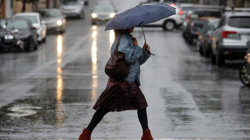 A woman walks in the rain in San Francisco in this file photo. (Jeff Chiu/AP)