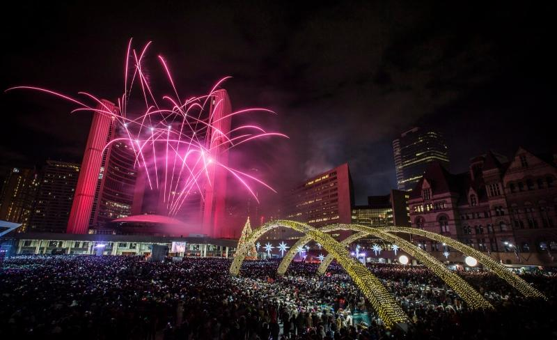 Fireworks explode during New Year's Eve celebrations at Nathan Phillips Square in Toronto, on Wednesday, Jan. 1, 2014. (Mark Blinch / THE CANADIAN PRESS)