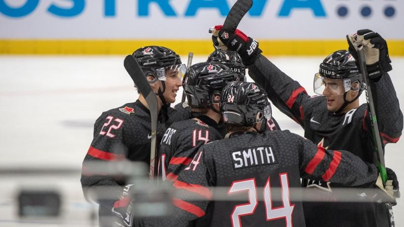 Canada's Dylan Cozens (22), Jared McIssac (14) Liam Foudy (8), Ty Smith (24) and Joe Veleno (9) celebrate their seventh goal against the Czech Republic's during third period action at the World Junior Hockey Championships. THE CANADIAN PRESS/Ryan Remiorz
