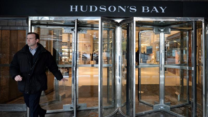 A man leaves the downtown Toronto flagship Hudson Bay Company store in Toronto, Jan. 27, 2014. (Nathan Denette / THE CANADIAN PRESS)