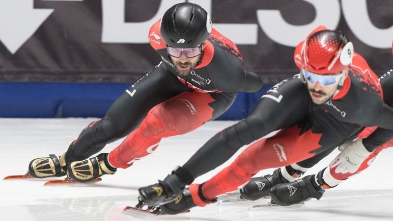 Charles Hamelin, of Canada, left, closes in on Steven Dubois, of Canada, during the men's 1500-metre semifinal race at the ISU Four Continents Short Track Championships in Montreal, Saturday, January 11, 2020. THE CANADIAN PRESS/Graham Hughes