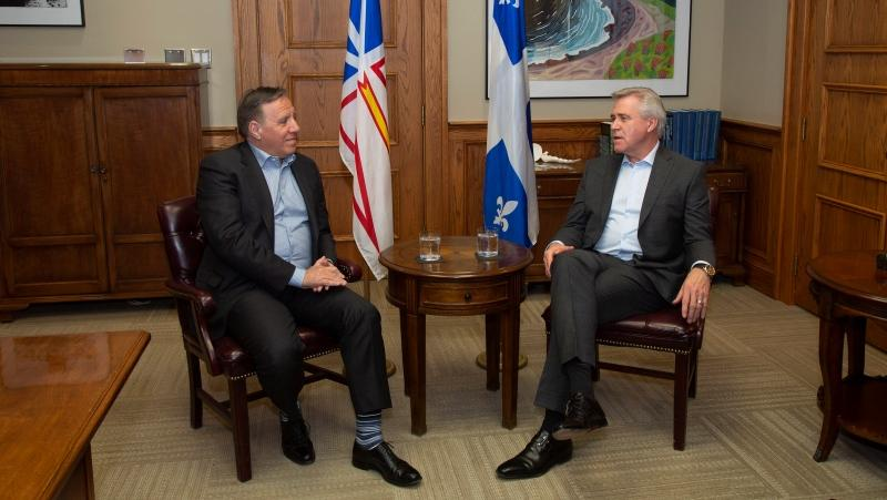 Quebec Premier Francois Legault, left, and Newfoundland and Labrador Premier Dwight Ball sit for a meeting ahead of the Atlantic Premiers' conference, at the Confederation Building in St. John's, Sunday, Jan. 12, 2020. (THE CANADIAN PRESS/Paul Daly)