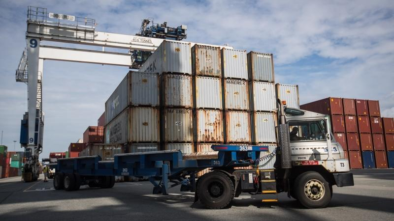 Some of the 69 containers of Canadian trash that were returned to Canada from the Philippines are stacked at Global Container Terminals after being offloaded from the Anna Maersk container ship, in Delta, B.C., on Saturday, June 29, 2019. The federal government expects to make some changes this year to keep Canada's garbage from ending up on foreign shores without consent. (THE CANADIAN PRESS/Darryl Dyck)
