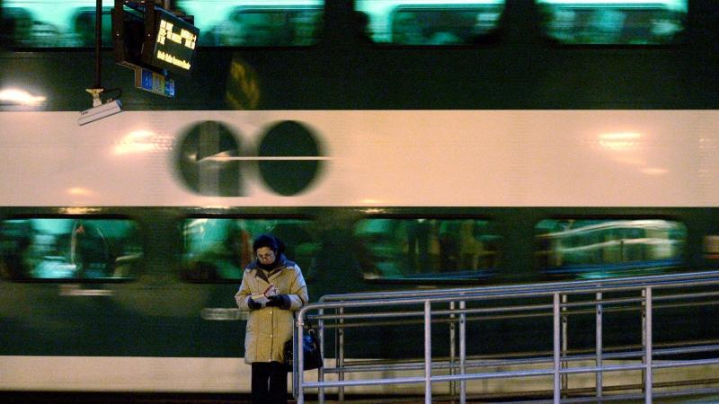 A woman reads a book as a GO commuter train pulls away from the platform at Toronto's Union Station, March 4, 2008. Friday June 24, 2011. THE CANADIAN PRESS/J.P. Moczulski