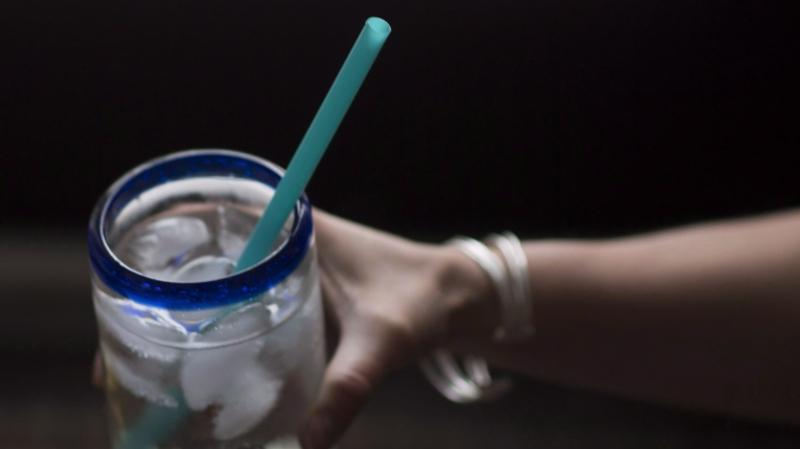A plastic straw is pictured in a ice cold drink in North Vancouver, B.C., Thursday, June, 7, 2018. Vancouver is phasing-in bans on the use of plastic bags, disposable cups, plastic straws and other single-use items. (The Canadian Press / Jonathan Hayward)