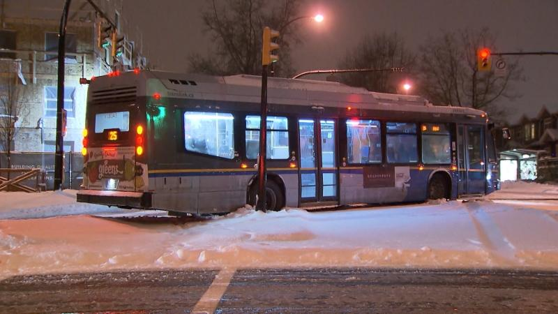 A bus is stuck in Vancouver due to snowy conditions on Jan. 13, 2020.