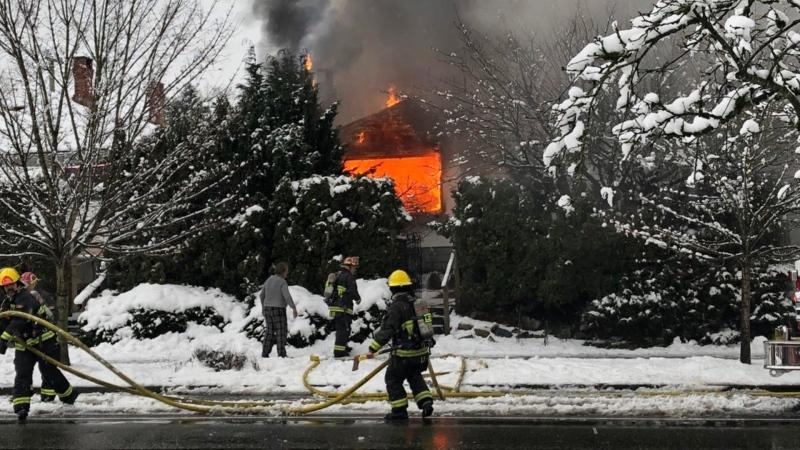 Firefighters battle a house fire near Cambie Street and 37th Avenue on Tuesday, Feb. 4, 2020. (Twitter/Const. James Hooper)