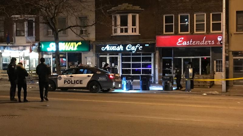 Police are seen on Danforth Avenue near Greenwood Avenue on Feb. 5, 2020 after a fatal shooting. (Mike Nguyen/CP24)