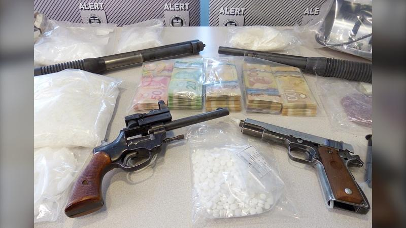 Police seized drugs, cash and guns in a recent bust by members of the Alberta Law Enforcement Response Teams. (Courtesy ALERT)