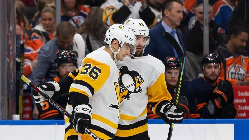 Pittsburgh Penguins' Joseph Blandisi (36) and Zach Aston-Reese (46) celebrate a goal during first period NHL action against the Edmonton Oilers, in Edmonton on December 20, 2019. THE CANADIAN PRESS/Codie McLachlan