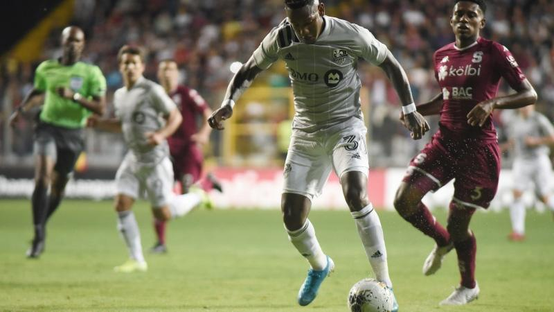 Forward Romell Quioto of Canada's Montreal Impact drives the ball to score against Costa Rica's Deportivo Saprissa during a CONCAFAF Champions League soccer match at the Ricardo Saprissa Stadium in San Jose, Costa Rica, Wednesday, Feb. 19, 2020. (AP Photo/Carlos Gonzalez)