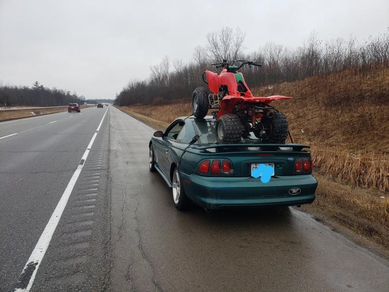 On Tuesday, OPP tweeted pictures of a car with an ATV strapped to the roof.