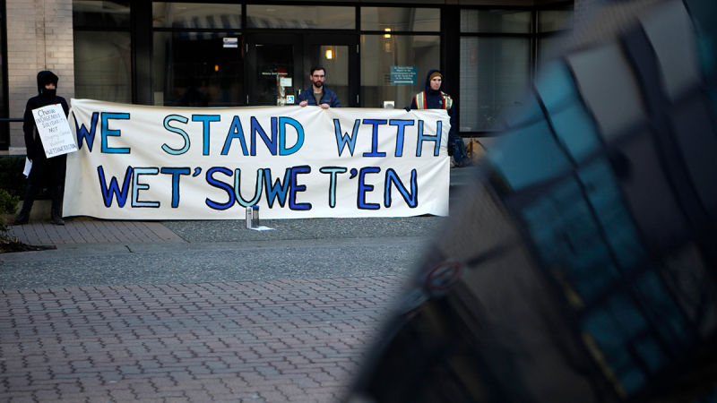 Wet'suwet'en supporters and Coastal GasLink opponents protest 20 government buildings throughout Victoria, Friday, Feb. 14, 2020. (Chad Hipolito / THE CANADIAN PRESS)