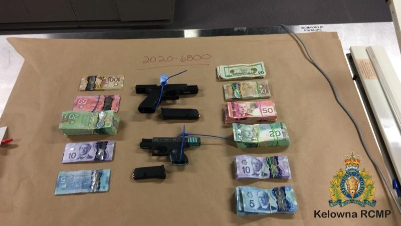No adults were arrested during the search, during which police seized drugs, guns and $30,000 in cash. (Kelowna RCMP)
