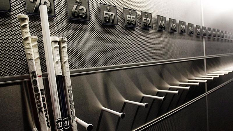 A nearly empty hockey stick rack in the locker room of the Buffalo Sabres hockey team on Sept. 25, 2012. (AP / David Duprey)