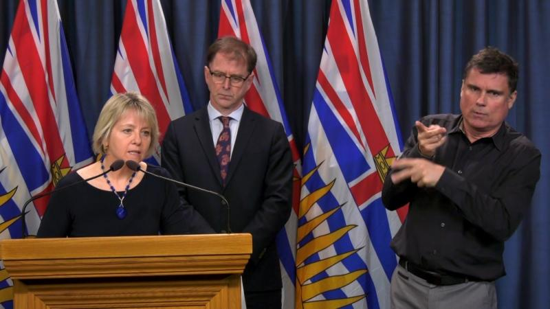 Provincial health officer Dr. Bonnie Henry, left, announces three more deaths related to COVID-19 in B.C. on Monday, March 16, 2020.