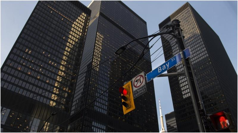 The futures market suggested U.S. stock markets would open higher today, a day after North American stock markets posted gains. Bay Street in Canada's financial district is shown in Toronto on Wednesday, March 18, 2020. THE CANADIAN PRESS/Nathan Denette