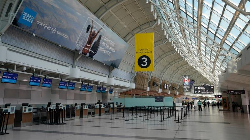An almost-empty Terminal 3 is shown at Pearson International Airport in Toronto, Friday, March 13, 2020. Provincial governments have advised against international travel and Ontario announced plans to close its schools for two weeks because of COVID-19.THE CANADIAN PRESS/Frank Gunn