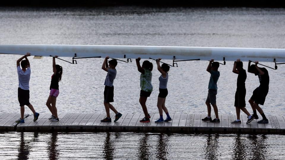 Rowers carry a shell after pulling if from the Hudson River during rowing summer camp at the Albany Rowing Center on Friday, July 10, 2015, in Albany, N.Y.